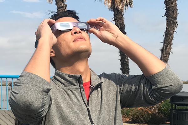 Solar eclipse employee watching